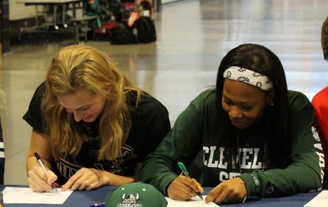 Seniors Louise Kiekhofer (left) and Mariah Miller sign their letters of intent for college athletics. Louise will play volleyball at UW-Milwaukee and Mariah will play basketball at Cleveland State.