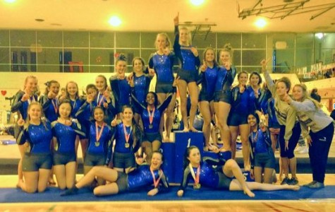 JV and Varsity gymnasts celebrate their conference victories on February 19. Photo credit: Brookfield Gymnastics