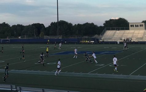 Brookfield East and Madison Memorial fight for control of the ball