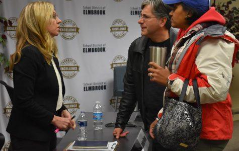 Entrepreneur Robin Vining (D) discusses school vouchers with two constituents.