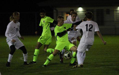 Junior Keegan Mihm makes his way through the Wauwatosa West defense