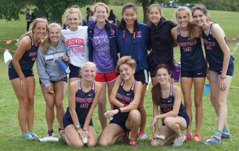 The girls of varsity cross country celebrate a solid showing at their conference meet.