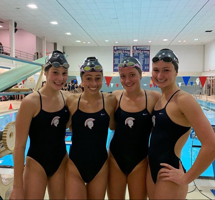 Lucy Thomas (Left) with her teammates: Abby Wanezek, Reese Tiltmann, and Reilly Tiltmann
