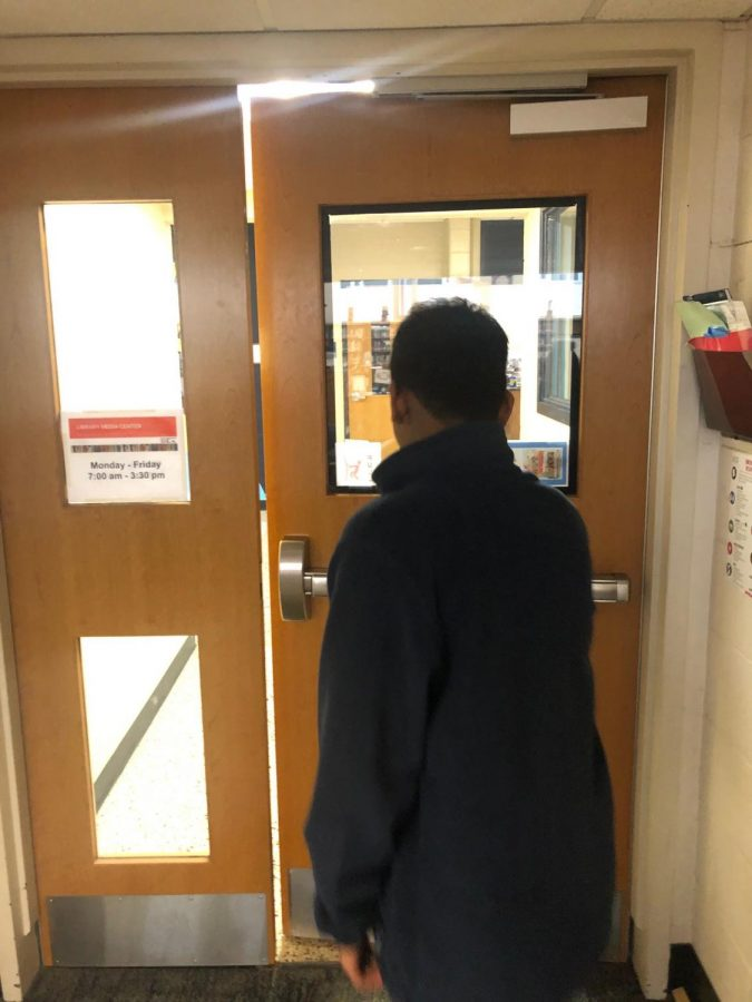 Antony (12) walks out of the library, tired of hearing about databases